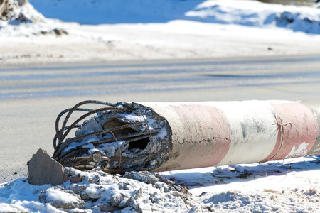 slump: Concrete electric pole fell next to the road (emergency power supply) Stock Photo