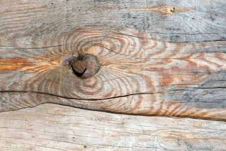 chap: Board (plank) of wood. Old and cracked. The surface is rough and uneven.