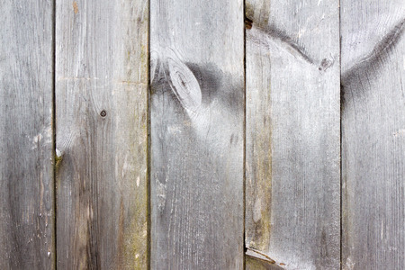 infirm: Plank (board) of wood. Old and cracked. The surface is rough and uneven.