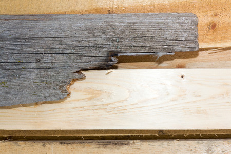 the outmoded: Board (plank) of wood. Old and cracked. The surface is rough and uneven.