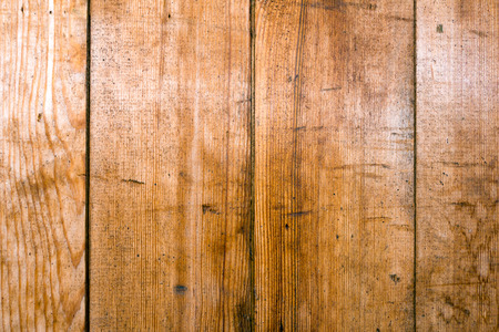 unequal: Board (plank) of wood. Old and cracked. The surface is rough and uneven.