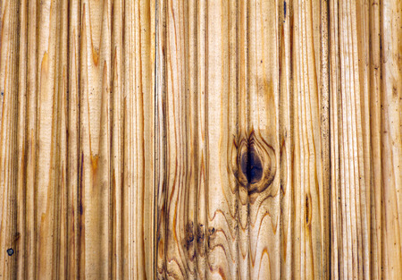 the outmoded: Plank (board) of wood. Old and cracked. The surface is rough and uneven.