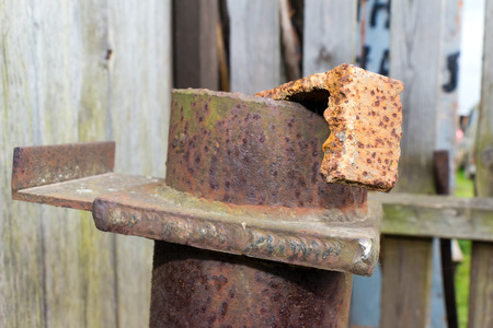 flawed: Steel element of iron corroded by rust. Very old. Strong influence of water. Much time was on the outdoor. Stock Photo