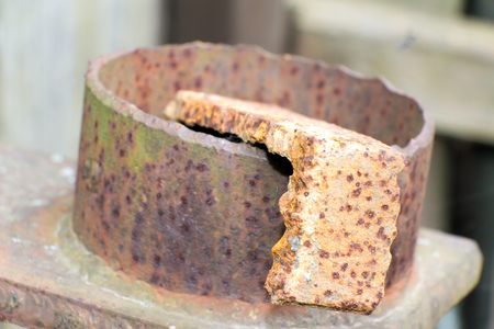 Steel element of iron corroded by rust. Very old. Strong influence of water. Much time was on the outdoor. Stock Photo