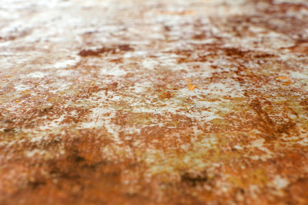 depletion: Steel sheet of iron corroded by rust (background). Very old. Strong influence of  water. Much time was on the outdoor.