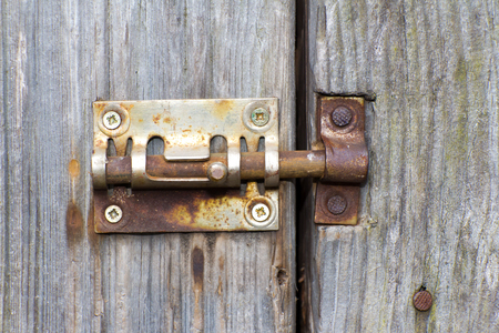 depletion: Steel lock of iron corroded by rust. Very old. Strong influence of water. Much  time was on the outdoor.