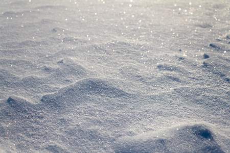globule: Snow grains close up. Blurred in the distance. Snow cover is not smooth.