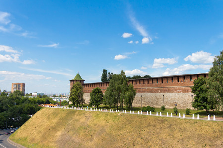 Koromyslova tower (Beam), the Kremlin, Nizhegorodskiy district, Nizhny Novgorod, Russia. Tower and wall of red brick. A tourist attraction. The building is old and vintage. Standing on the hill.
