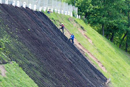 landslide: Works to strengthen the slope. The installation of the grid. Using this material can  grow grass. A struggle with the landslide. Stock Photo