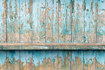 The old fence boards with chink. Painted light blue paint. From old age, almost all the coating peeled off.