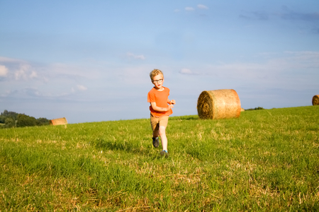runing: runing boy with glasses on green meadow