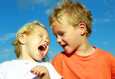 sibling: sibling, boy and girl are playing together and laugh