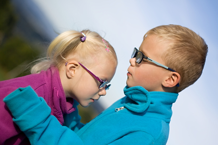 sibling: portrait of little blonde girl and boy sibling outdoor Stock Photo