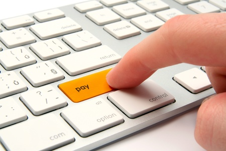 non cash: Keyboard with golden button pay - electronic payment and e-banking concept Stock Photo