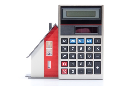 occupancy: Home financing (cost of occupancy) concept - model of the house and calculator