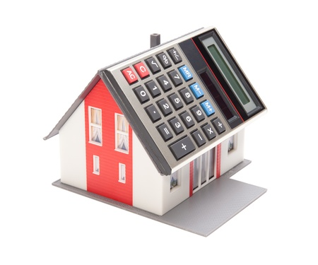 occupancy: Home financing (cost of occupancy) concept - model of the house with calculator instead of the roof
