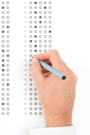 probation: Student complete the questionnaire - school exam concept. Top view