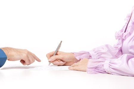 Man help woman with filling the form or sign contract  photo