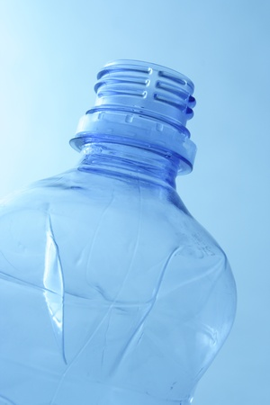 poach: Empty plastic water bottle. Recycle garbage.