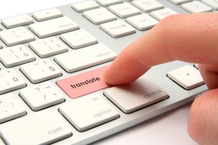 translator: Virtual translator concept - modernized computer keyboard with translate keypad Stock Photo