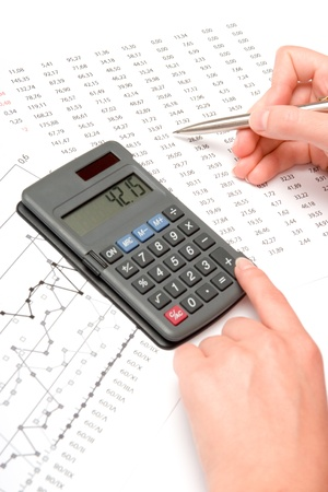 Concept of woman business analyst - calculator, sheet and graph photo