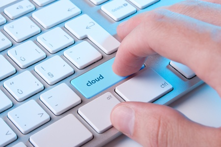 Cloud computing concept - computer keyboard with cloud button Stock Photo