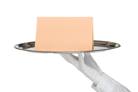 Waiter with white protective gloves holding silver tray with card - white background photo