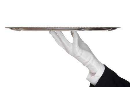 serving tray: Waiter with white protective gloves holding empty silver tray - white background Stock Photo