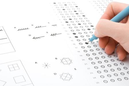 Hand filling IQ test - intelligence measuring concept
