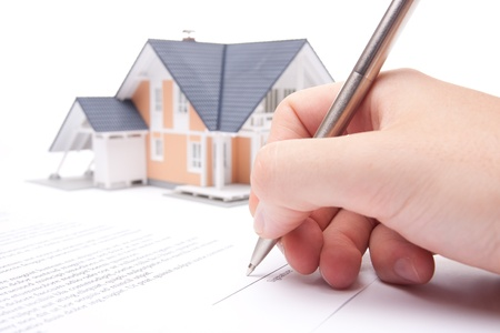 Man confirm mortgage contract (estate agency client sign contract) photo