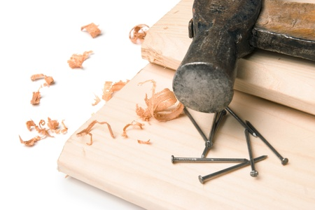 sawdust: Handyman workplace still-life - hammer, nails, sawdust and plank