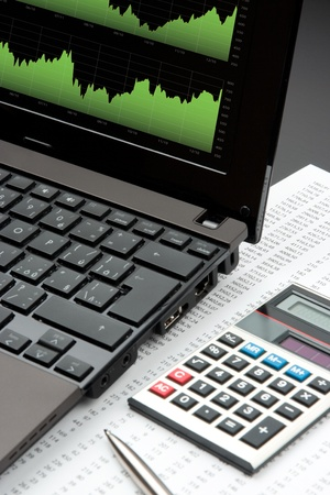 Modern stock market analyze with laptop, calculator, pen and printed data sheet Stock Photo - 11849537