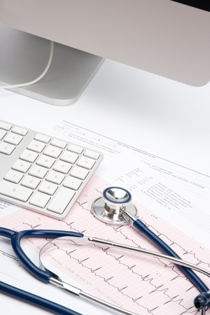 general practitioner: Part of stethoscope, electrocardiogram (ECG), medical form and part of computer - general practitioner doctor workplace