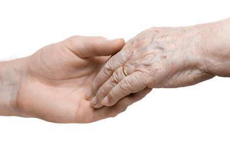 multigeneration: Young man gives grandmother his helping hand - multi-generation family concept Stock Photo