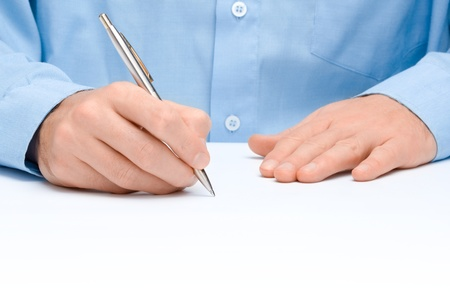 Male hand with pen write something on white background photo