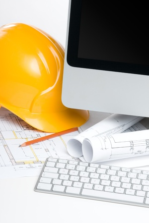 superintendent: Construction manager workplace with blueprints, computer, protective helmet and pencil