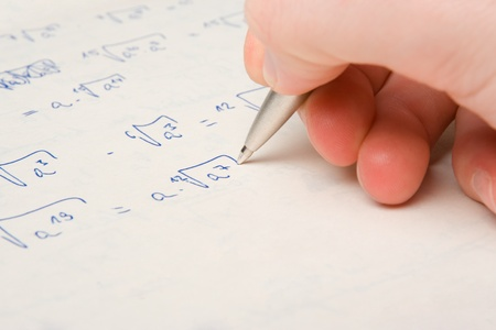square root: Square root exercise study - mathematician student Stock Photo