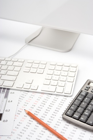 Concept of business analyst workplace - pencil, sheet with numbers, graph, keyboard, computer and calculator photo