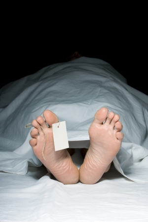 Dead man - feet with tag Stock Photo - 11850205