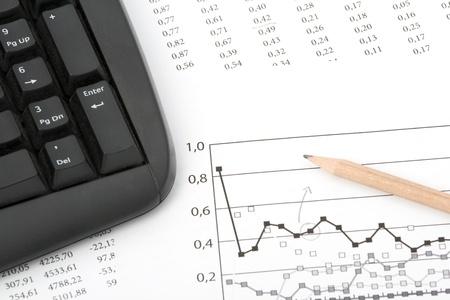 Concept of market share analysis - pencil; graph; sheet with numbers and keyboard photo