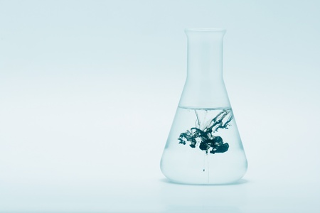 Blue tint glass chemical flask photo