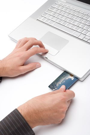 Laptop with credit card plug-in for electronic payment photo
