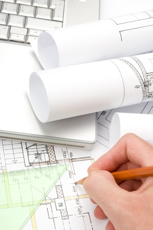 superintendent: Blueprints of architecture, hand holding pencil and laptop Stock Photo