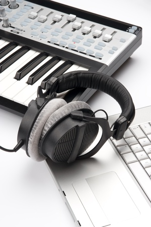 recording studio: Contemporary composer workplace with laptop, headphones and MIDI controller