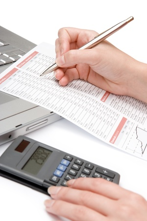 spreadsheets: Concept of woman business analysis - sheets, graph, calculator and laptop Stock Photo