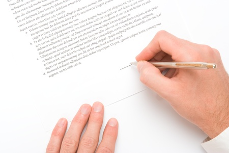 signing a contract: Signing a contract - hand with pen closeup Stock Photo