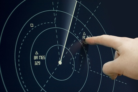 traffic control: Air traffic controller point to plane on radar (sonar) - Air Traffic Control Tower Stock Photo