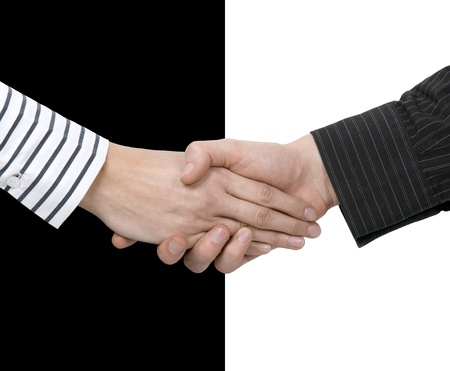 Contrast shake hands - concept of gender conciliation and diversity in business
