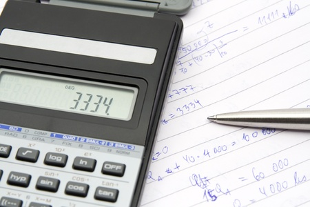 Student calculate economical example - calculator, pen, commonplace book photo