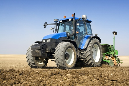 Agriculture - tractor sow the field Stock Photo - 11943833